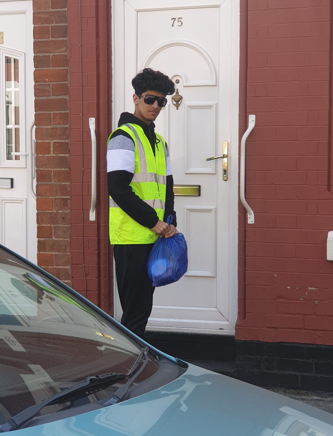 One of our young volunteers who have been helping to deliver parcels in these difficult times.