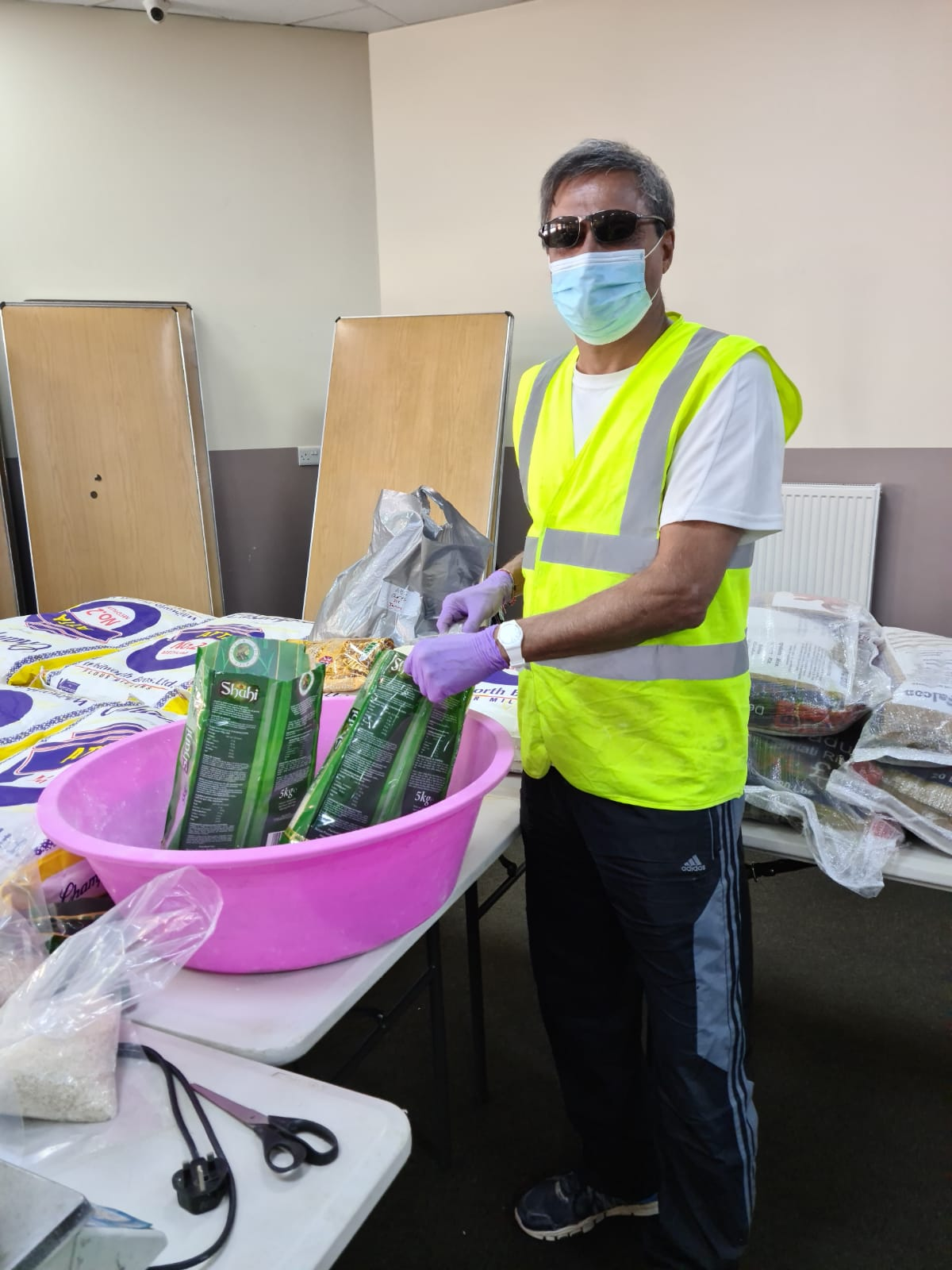 A Volunteers repacking bulk items into small parcels